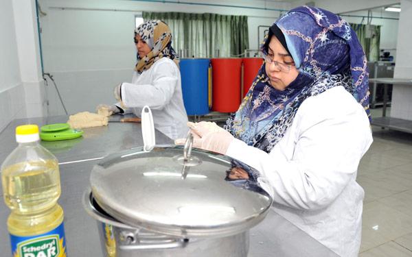 Naima Abu Abed and Faima Slama during a food processing class in the UNRWA Gaza Training Centre. © 2015 UNRWA Photo by Khalil Adwan