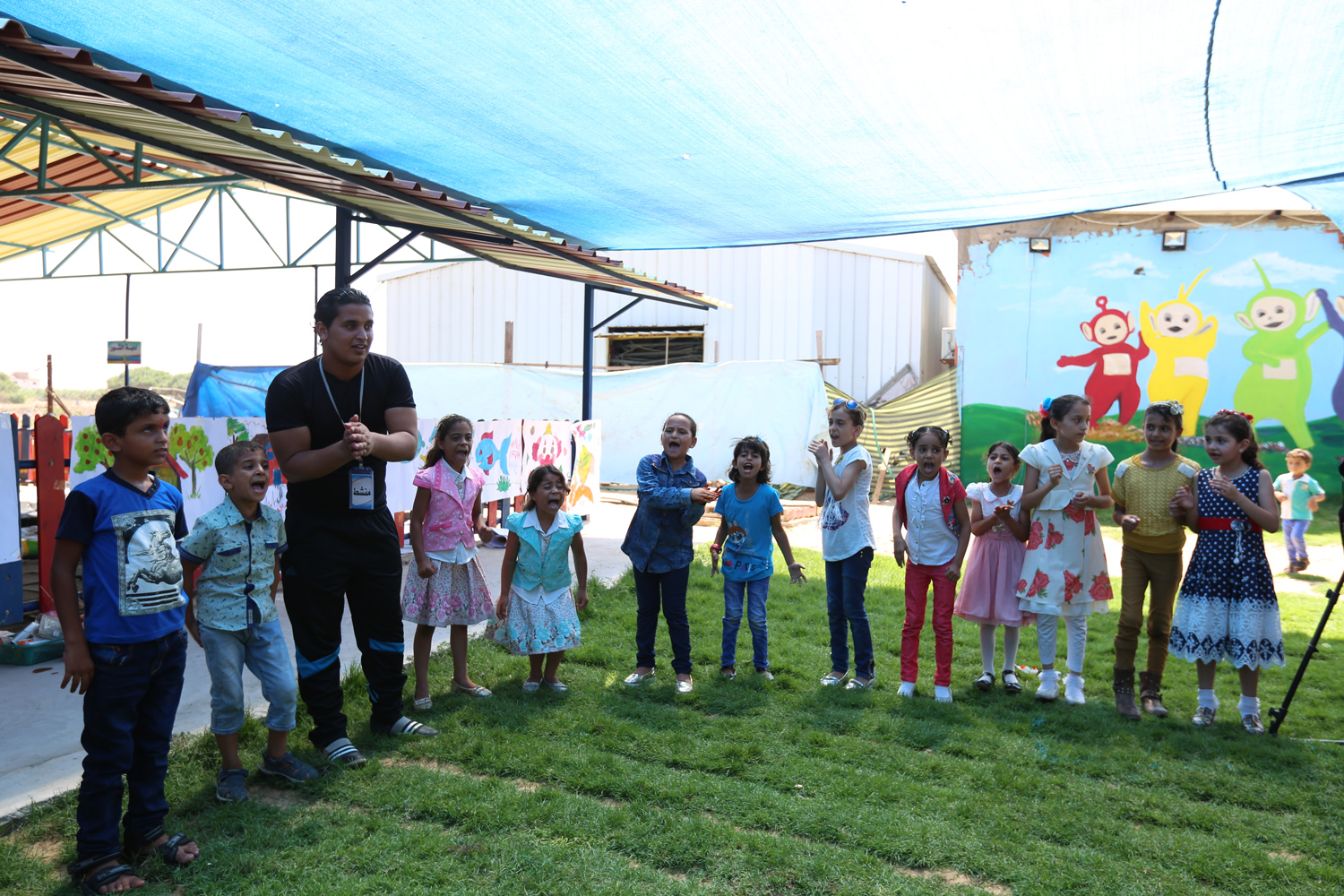 Nine-year-old Raghad Al Jarba and her sister Roaa participating with the animator during the recreational day conducted at Sharm Park by the UNRWA Relief and Social Services Programme. Photo credit: © 2016 UNRWA Photo by Tamer Hamam