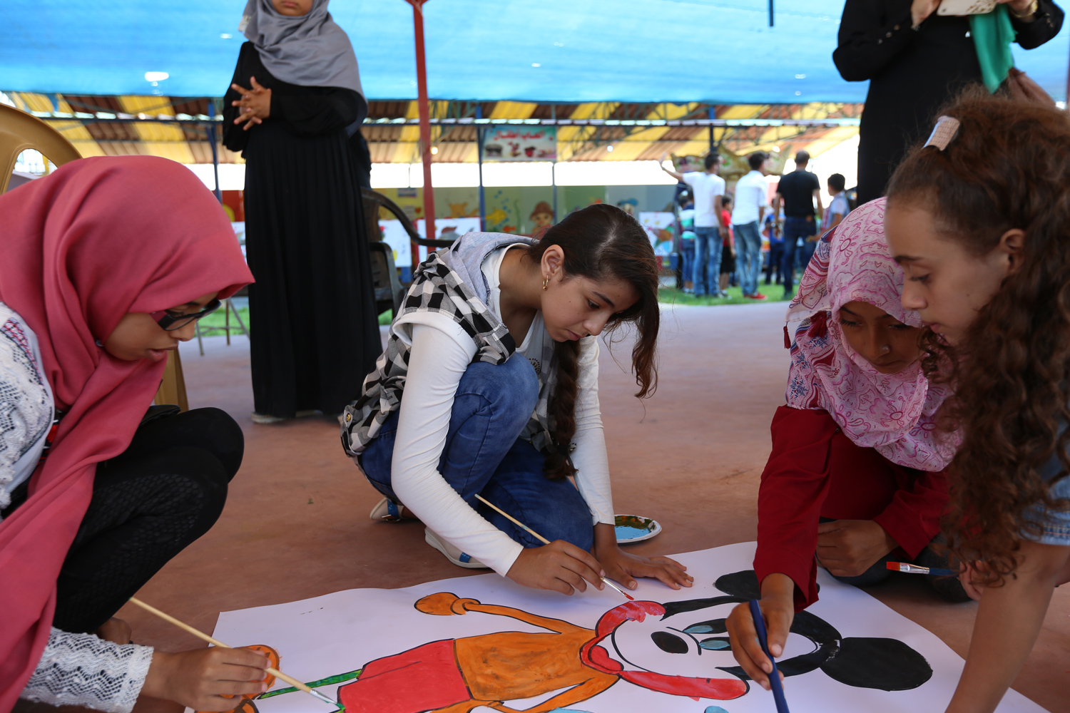 12-year-old Yaqeen Abu Saeed participating in a drawing activity, one of the activities implemented during the recreational trips conducted by the UNRWA Relief and Social Services Programme. © 2016 UNRWA Photo by Tamer Hamam