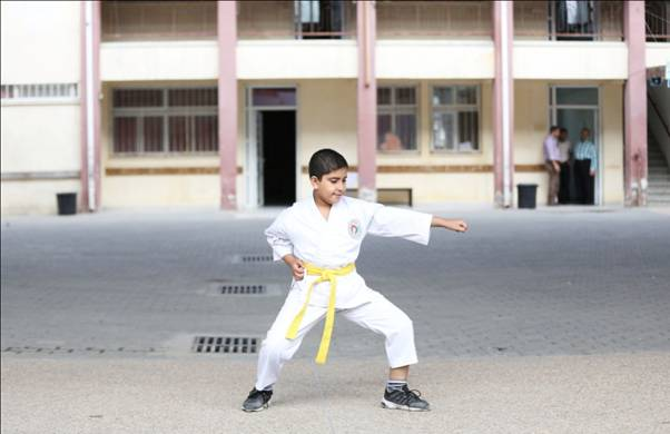 Student Abdel Rahman Shubeir proudly performs a karate move in the RCVI schoolyard in Gaza City. © 2015 UNRWA Photo by Tamer Hamam