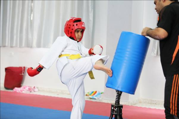 Abdel Rahman Shubeir performs a karate move during one of the karate training classes at al-Mashatal sports club. © 2015 UNRWA Photo by Tamer Hamam