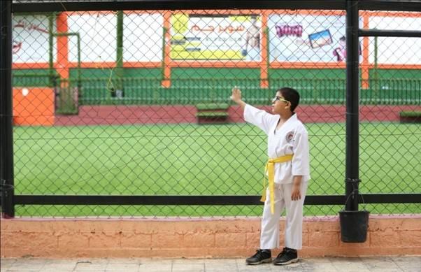 RCVI student Abdel Rahman Shubeir eagerly waits at al-Mashtal sports club to start his daily karate training. © 2015 UNRWA Photo by Tamer Hamam