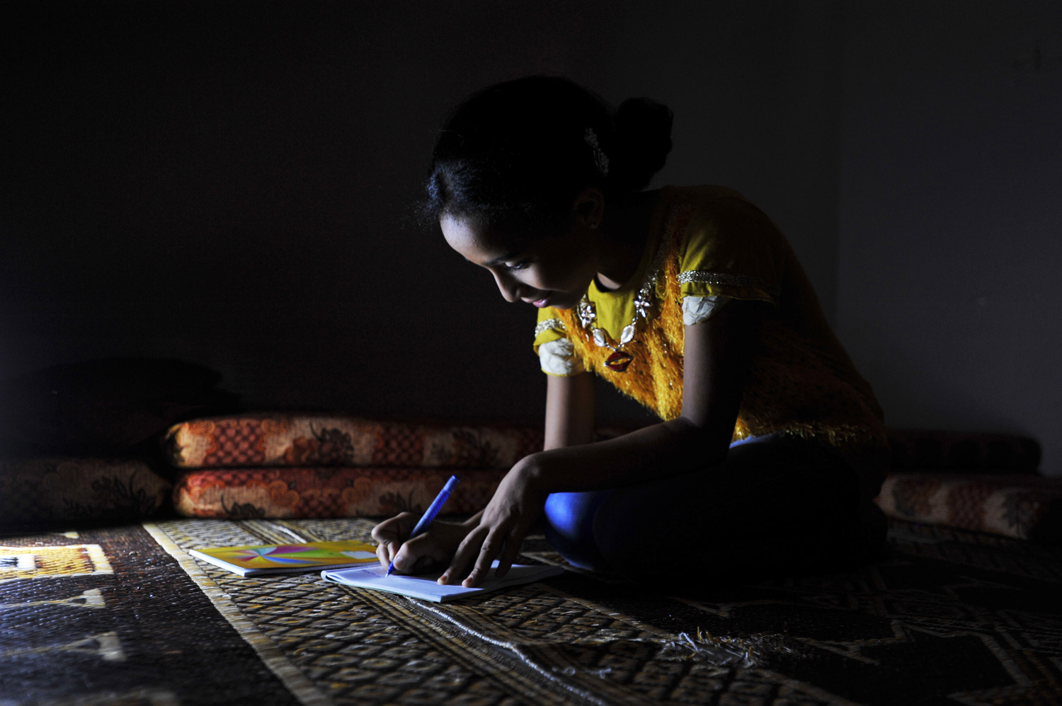 11-year-old Saja, from the area of Sha'af in the eastern side of Gaza City, thinks about the difficult times she had last year when school commenced after the 2014 conflict. She remembers trying to finish her homework by the dim lights during consistent electricity cuts. Since 2006, the Gaza Strip has been plagued by a chronic electricity crisis with rolling blackouts that last between 12 to 16 hours per day that heavily affect the most populated areas. © 2015 UNRWA Photo by Ahmad Awad