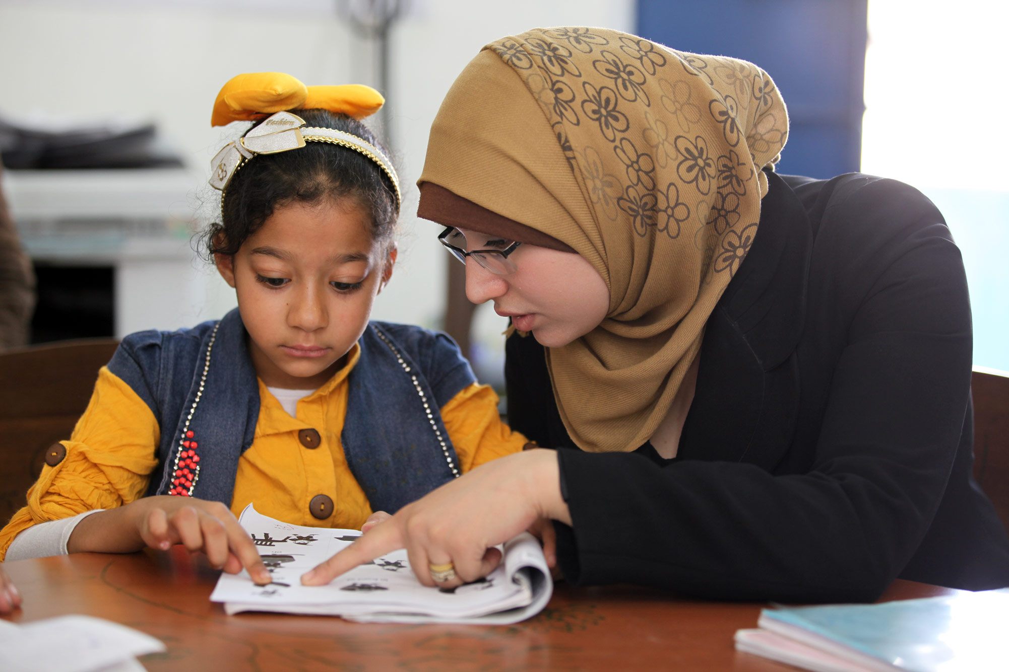 Seven-year-old Aya, originally from Jaramana camp in Damascus, was one of the thousands of Palestine refugee children who were excited to return to school in September 2015. Her story is just one example of the ongoing conflict's devastating impact on civilians in Syria, including Palestine refugees. In addition to physical injuries sustained as a result of the crisis, Palestine refugee children in Syria are suffering from psychological trauma caused by displacement, hardship and insecurity. UNRWA has trained 55 counsellors in Syria to provide psychosocial support to 45,000 students who attend UNRWA schools. © 2015 UNRWA Photo by Taghrid Mohamm