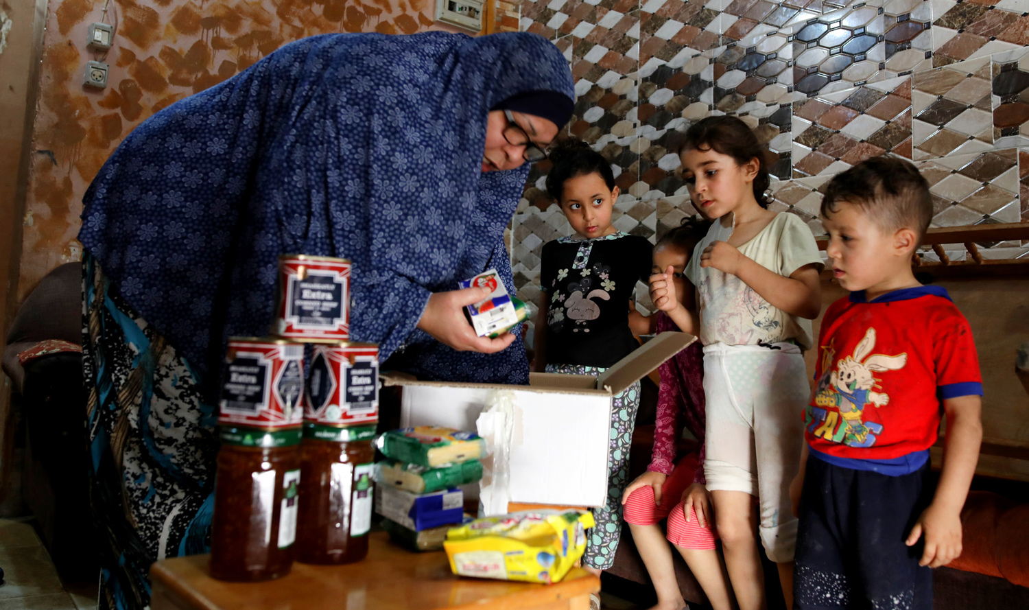 UNRWA delivers food parcels to Palestine refugee families in Gaza. © 2020 UNRWA Photo by Hussein Jaber