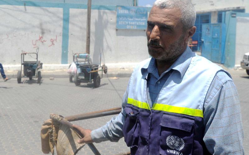 #GazaOneYearLater, Mohammed Saeed Aaraisha, UNRWA sanitation worker, August 2014 © 2014 UNRWA Photo