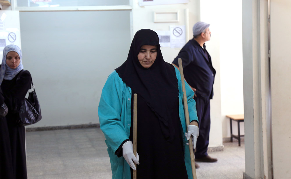 Since 2008, Khadra Kalloub works as a cleaner in the UNRWA Health Centre in Beach refugee camp and is able to provide for her and her family. © 2015 UNRWA Photo by Khalil Adwan