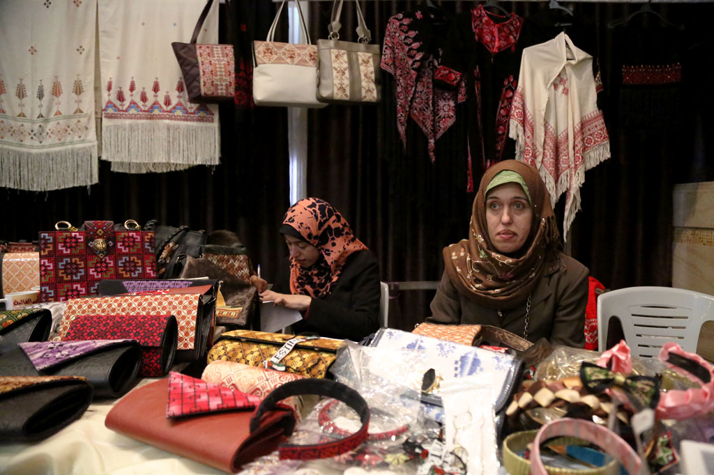 "36-year old Palestine refugee Huda Abu Oda is selling her handmade products at the ""Our Women Products"" exhibition in the Women's Affairs Centre in Shahelat in Gaza city on 16 March. © 2016 UNRWA Photo by Tamer Hamam"