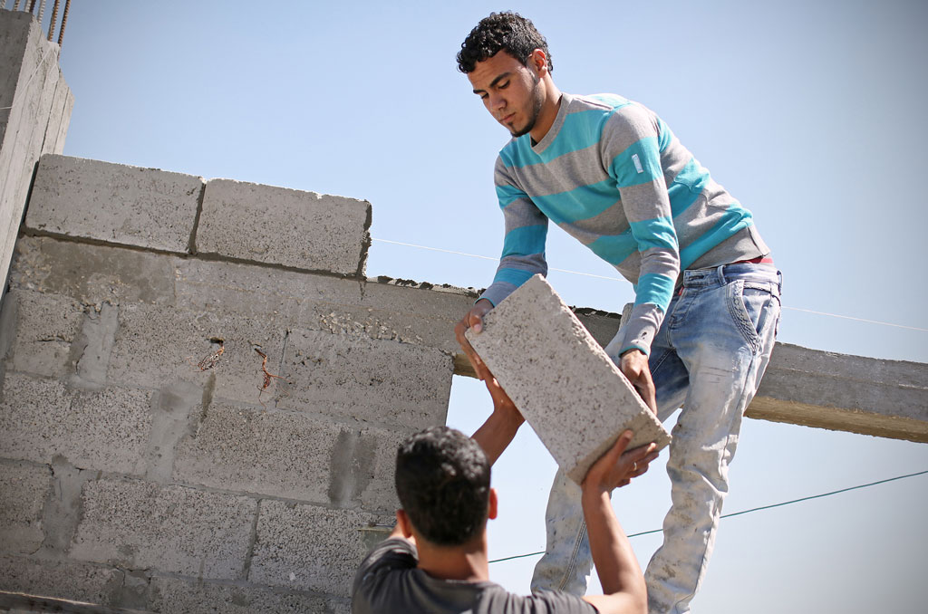 18-year old Mohammad Bassam Al Masri is applying the masonry skills he acquired during a vocational training at the UNRWA Gaza Training Centre to repair his own family house in Beit Hanoun, northern Gaza. The house suffered major damage during the 2014 conflict, but was not rendered uninhabitable. © 2016 UNRWA Photo by Tamer Hamam