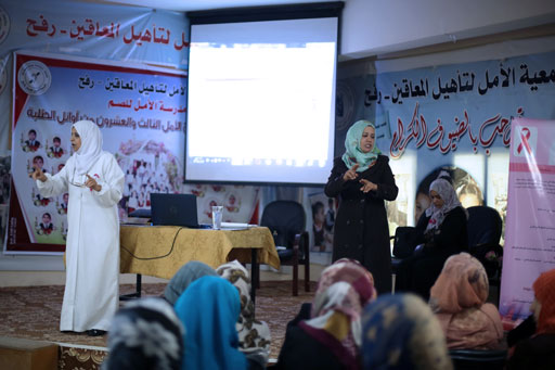 UNRWA senior nurse Jamalat Abu Hilal (on the left) is leading an awareness session for deaf women in Al Amal Association in Rafah, southern Gaza. © 2016 UNRWA Gaza Photo by Tamer Hamam
