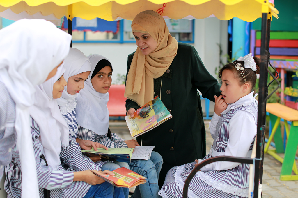 35-year-old school counsellor Rola Al Hindi during a reading activity about tolerance in Al Amal Preparatory Girls School in Khan Younis, southern Gaza. © 2016 UNRWA Photo by Rushdi Al Sarraj