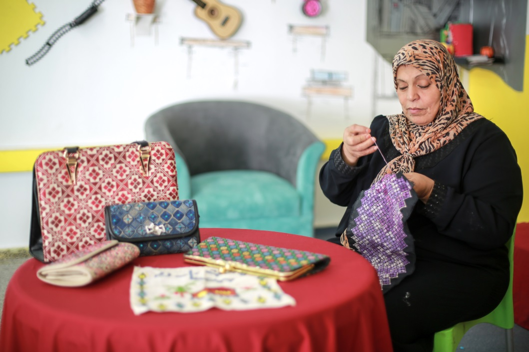 59-year-old Fadwa Abu Shaieb has opened an embroidery business with support from the UNRWA microfinance programme. © 2016 UNRWA Photo by Rushdi Al Sarraj