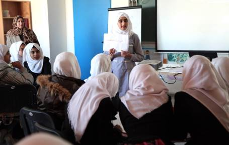 "15-year old Malak Arab, a 9th grade student, presents during a lesson on adolescent health in the UNRWA Jabalia Prep Girls ""A"" school in northern Gaza. Photo credit: ©UNRWA Gaza 2015. Photo by Khalil Adwan."