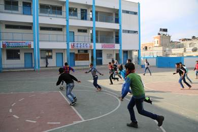 13-year old Yousef Safi is playing football with his friends during a break at the UNRWA Khan Younis Preparatory Boys C School in southern Gaza. © 2016 UNRWA Photo by Tamer Hamam