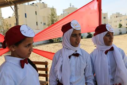 "UNRWA students, dressed as waitresses, participating in an activity called ""Al Madina Al Monawra restaurant for healthy food"" during the opening ceremony of the UNRWA healthy lifestyle campaign in Rafah, southern Gaza. © 2016 UNRWA Photo by Nathalie Schmidhauser"