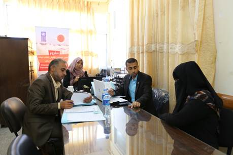 Lawyers, hired through the UNRWA Job-Creation Programme, discuss with Fadwa her case in the legal unit of the UNRWA Women Programme Centre in Nuseirat camp, central Gaza. Photo credit: ©UNRWA Gaza 2016. Photo by Tamer Hamam.