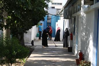 A group of cleaners during their work at the UNRWA Gaza Field Office. © 2016 UNRWA Photo by Tamer Hamam