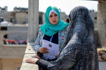 27-years old Haneen Atallah is speaking to an UNRWA beneficiary in her home in Beit Hanoun, northern Gaza. © 2016 UNRWA Photo by Rushdi Al-Saraj