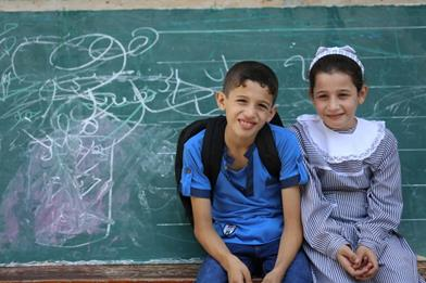 Two UNRWA students after finishing the first school day of the school year 2016-2017. © 2016 UNRWA Photo by Tamer Hamam