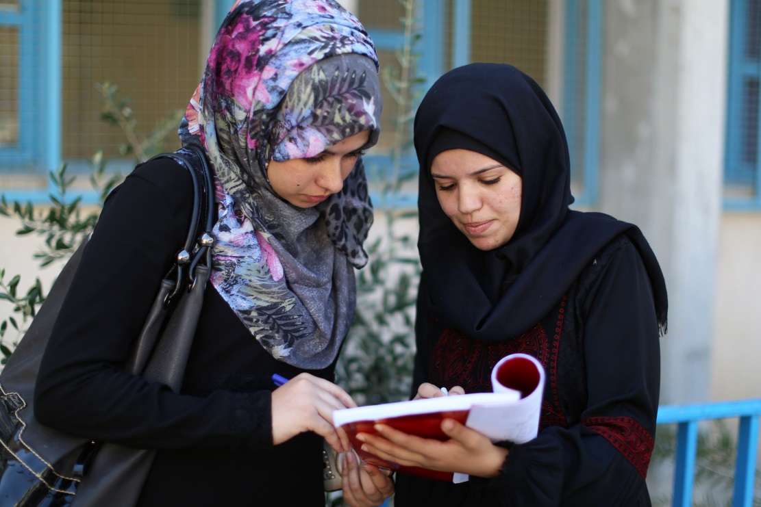 19-year-old Heba Abu Gedian (right) is studying with her friend in the UNRWA Gaza Training Centre in Gaza city. © 2016 UNRWA Photo by Tamer Hamam