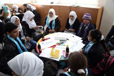 Approximately 30 male and female students and five parents were participating in a discussion on early marriage, organized by the School Parliament of the UNRWA Mustafa Hafez Co-ed School in Khan Younis, southern Gaza. © 2015 UNRWA Photo by Ibrahim Yaghi