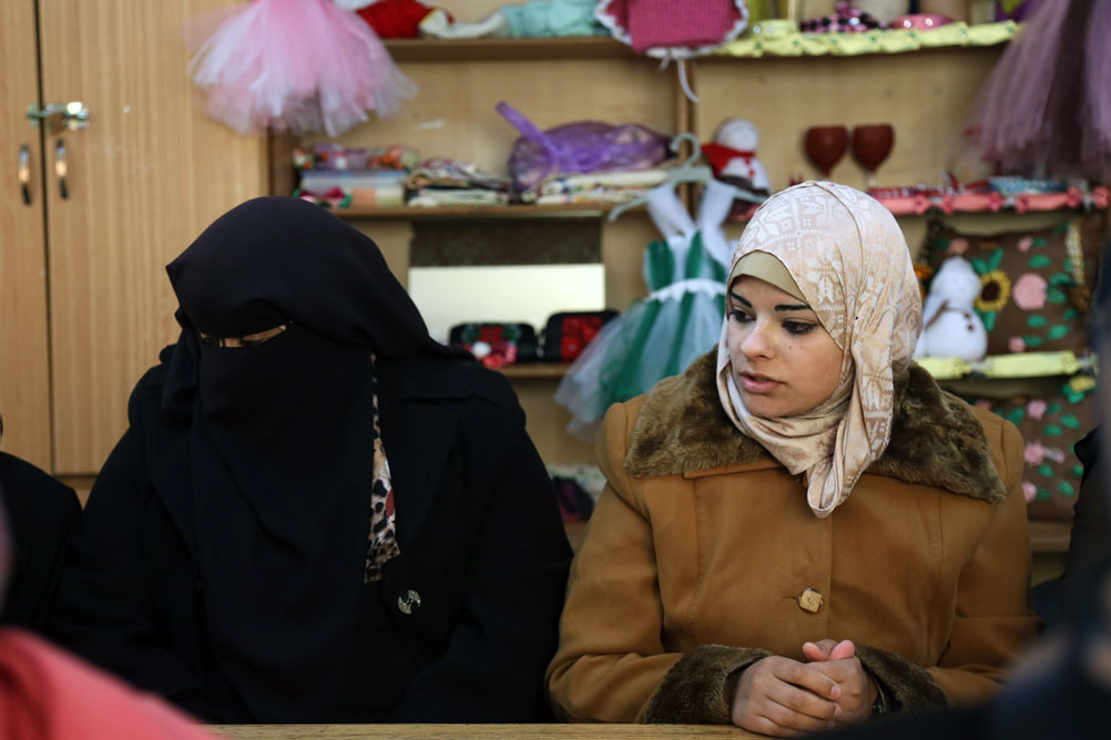 Two women from the initiative-committee during a discussion on the next steps of their campaign to improve the safety and security in their community. © 2016 UNRWA Photo by Tamer Abu Hamam