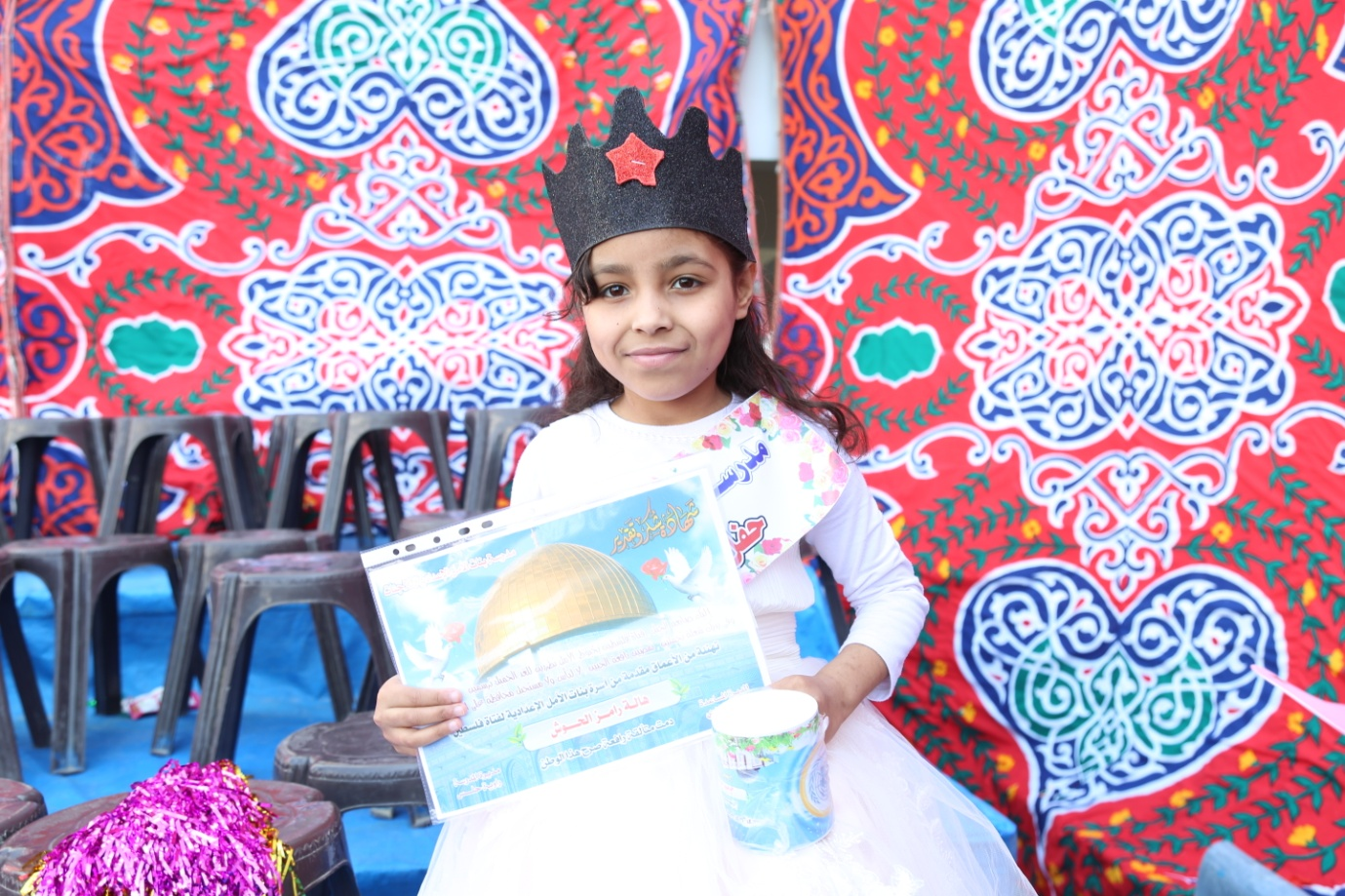 Hala al-Housh, a fourth grade student at the honouring ceremony at Al-Amal Preparatory Girls' School in Khan Younis. © 2016 UNRWA Photo by Ibrahim Yaghi