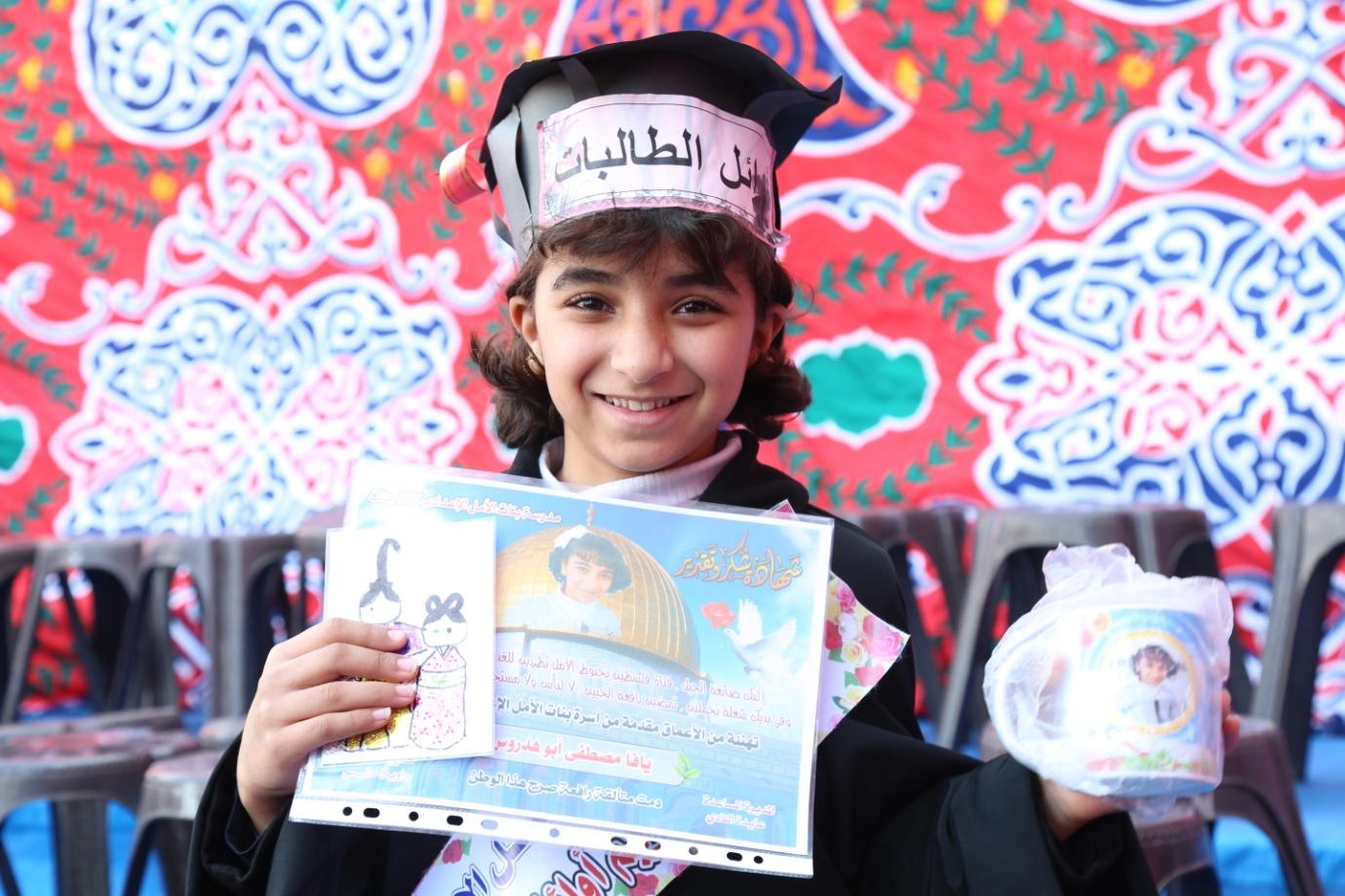 Yafa Abu Hadrous, a sixth-grade student at the honouring ceremony at Al-Amal Preparatory Girls' School in Khan Younis. © 2016 UNRWA Photo by Ibrahim Yaghi