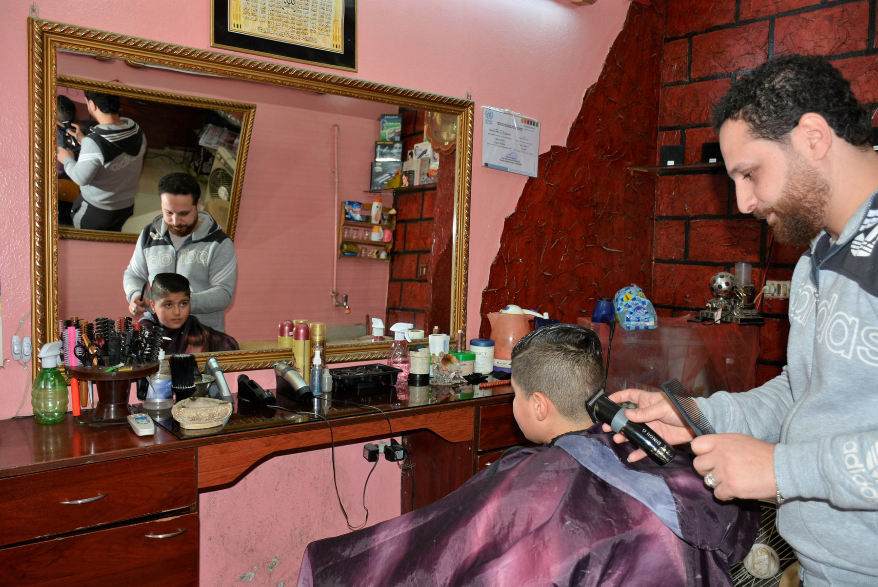 Obeida Shaabi opened up his own hairdressing salon after completing an UNRWA short course. © 2018 UNRWA Photo by Fernande van Tets