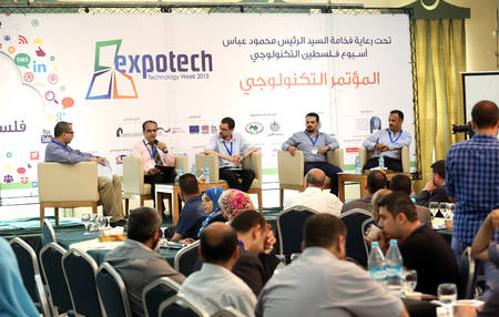 Ibrahim Jobour (second from the right), one of the three co-founders of the UNRWA supported social enterprise Gaza Gateway, is participating in a panel discussion at the Gaza Expotech Technology Week, held from 5 to 8 October. © 2015 UNRWA Photo by Khalil Adwan