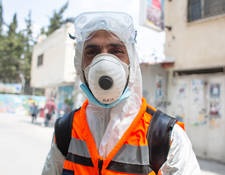 "Mohammad Abu Ayyash has been an environmental health laborer with UNRWA for thirteen years. ""Some people don't mind when we tell them not to dispose of facemasks in the street, others don't like it. People look to UNRWA and rely on our services."" He adds, ""The camp population has increased which has also increased our workload.  There's a need for more laborers."" The Agency hired an additional five sanitation staffers in response to Balata camp's COVID-19 response. ""We disinfect the houses of those who are infected and quarantined. We also disinfect clinics on Wednesdays when the medical staff change their shifts weekly."" © 2020 UNRWA Photo by Louise Wateridge"