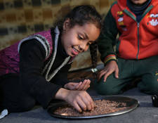 According to the World Health Organization (WHO), opting for a balanced, adequate and varied diet is an important step towards a happy and healthy lifestyle. To support Palestine refugees' nutritional intake, UNRWA provides 700 kcal per day per person, a third of their daily calorific need. Al-Ariha School collective shelter, Khan Dunoun, Syria. © 2016 UNRWA Photo by Taghrid Mohammad
