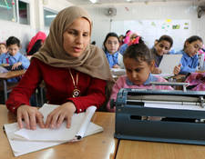 UNRWA is working to adapt learning materials and instructional techniques to provide tailored in-classroom and extracurricular support sessions. At the Mazar School in Beddawi camp, Lebanon, Braille materials facilitate the inclusion of students with visual impairments. © 2017 UNRWA photo by Maysoun Mustafa