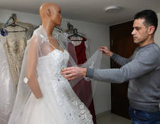 Ra'ed Imad opened his dress shop in Jaramana, near Damascus, 14 years ago. He took out his first loan in 2007, for 15,000 SYP, approximately US$ 300 USD at the time, to allow him to expand his business. In 2011, just before the start of the conflict, he sold 100 dresses a year and moved to a large showroom.  But as the conflict continued, revenue from his business decreased – he currently sells around 60 dresses a year - and he could no longer afford the rent. © 2019 UNRWA Photo by Taghrid Mohammad