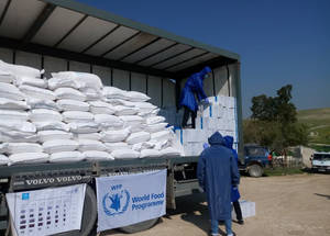 At the height of efforts to combat the new epidemic, UNRWA continues to provide services to beneficiaries wherever possible. As part of a joint project with the WFP, UNRWA began the first round of food distributions on March 25, 2020, to eight rural communities in eastern Bethlehem. Food distribution for isolated and remote locations in the West Bank is ongoing and is an essential service for people that cannot reach the cities due to movement restrictions imposed by local authorities. Before the distribution process kicked off, UNRWA equipped the distribution team with protective gear and masks and provided them with the necessary preparatory information to carry out their duty in a safe manner that guarantees their safety and that of the beneficiaries. © 2020 UNRWA Photo.