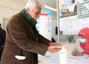 The Damascus Training Centre is one of 25 UNRWA health facilities in Syria that is continuing to deliver health services to Palestine refugees in coordination with the Syrian Ministry of Health and the World Health Organization (WHO), despite the rapidly changing situation on the ground. As part of the awareness and preventive measures campaign, posters and awareness material, with WHO and Ministry of Health guidelines on infection prevention and control were distributed across UNRWA installations and in the camps, and leaflets continue to be handed out to refugees. SMS messages have also been sent out to beneficiaries requesting that no children, or non-essential family members attend clinics and distribution centres. In its health facilities in Syria, the Agency has established a triage system for refugee patients, ensuring those with respiratory symptoms are separated from other patients and received by a dedicated team of medical staff to help prevent possible spread of COVID-19.  © 2020 UNRWA Photo. Tagh