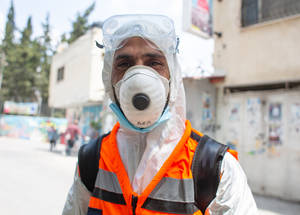 """Mohammad Abu Ayyash has been an environmental health laborer with UNRWA for thirteen years. """"Some people don't mind when we tell them not to dispose of facemasks in the street, others don't like it. People look to UNRWA and rely on our services."""" He adds, """"The camp population has increased which has also increased our workload.  There's a need for more laborers."""" The Agency hired an additional five sanitation staffers in response to Balata camp's COVID-19 response. """"We disinfect the houses of those who are infected and quarantined. We also disinfect clinics on Wednesdays when the medical staff change their shifts weekly."""" © 2020 UNRWA Photo by Louise Wateridge"""