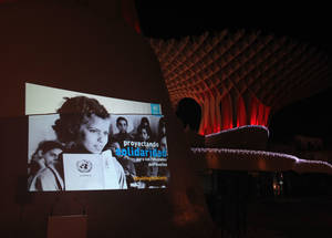 An iconic image from UNRWA's newly digitized archive projected in Seville, Spain as part of the Agency's Building Solidarity campaign to mark UN's International Year of Solidarity with the Palestinian People, 1 December 2014.