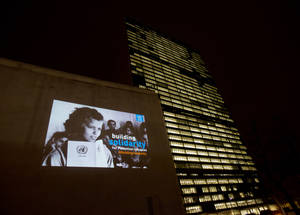 An iconic image from UNRWA's newly digitized archive projected on the UNHQ building, Manhattan, New York City as part of the Agency's Building Solidarity campaign to mark UN's International Year of Solidarity with the Palestinian People, 2 December 2014.