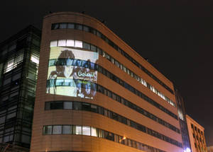 A photograph of an UNRWA school girl taken 1983 projected on the ESCWA building in Beirut as part of the Agency's Building Solidarity campaign to mark UN's International Year of Solidarity with the Palestinian People, 3 December 2014.
