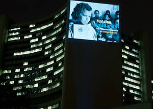 An iconic image from UNRWA's newly digitized photo and film archive projected on the UN building in Vienna to mark International Year of Solidarity with the Palestinian People.