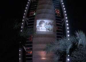 An iconic image from UNRWA's newly digitized photo and film archive projected on Burj Al Arab Hotel, Dubai to mark International Year of Solidarity with the Palestinian People.