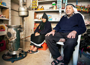 Oil burning stoves are widely used by Palestine refugees. The cost of heating fuel has risen steadily over the course of the conflict, with many families now forced to choose between food or heat for their shelters. Communicable disease is an increased risk during winter, as Palestine refugees struggle to retain a minimum level of nutrition and protection from falling temperatures. Jaramana Camp, Damascus. © UNRWA/Carole Al-Farah.