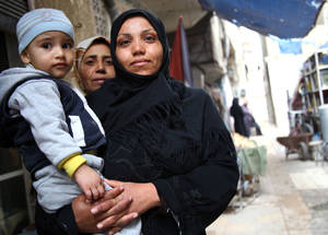 During the winter months, female-headed households are particularly vulnerable. Single mothers need cash assistance for warm food and clothes for their families. In a recent UNRWA evaluation of cash assistance, 95 per cent of respondents described cash assistance as the most useful form of humanitarian aid.  © UNRWA/Taghrid Mohammad.