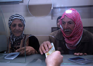 UNRWA provided regular cash assistance to 460,000 Palestine refugees across Syria in 2014. Cash assistance is particularly critical for vulnerable groups, such as the elderly, whose support networks have been fractured or displaced. Cash distribution point, Damascus, October 2014. © UNRWA/Taghrid Mohammad.