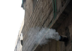 Housing in Palestine refugee camps in Syria is typically poorly insulated. Additional damage to buildings as a result of the conflict compounds the problem and causes hot air to escape, raising heating costs for inhabitants. Qabr Essit camp, Sit Zeinab, December 2014. © UNRWA.