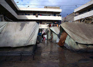 As winter storms arrive, the 12,868 Palestine refugees in Syria living in collective shelters face damp and uncomfortable conditions. Al-Rameh School Collective Shelter, Jaramana, Damascus, November 2014. © UNRWA/Taghrid Mohammad.