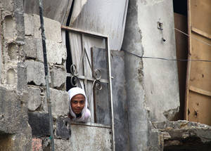 Continuous displacement is unaffordable and depressing. Some families, like those in Qabr Essit camp, are opting to return to their damaged homes to save on rental costs.  Families can then prioritize food, water and fuel, vitally important for the onset of winter. Qabr Essit camp, Damascus, December 2014. © UNRWA/Taghrid Mohammed.