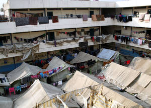Sixteen collective temporary shelters across Damascus and the surrounding areas house 12,868 displaced Palestine refugees. Many are unemployed and wholly reliant on UNRWA for cash, shelter and food. Al-Rameh School, Jaramana Collective Shelter, December 2014. © UNRWA/Taghrid Mohammad.