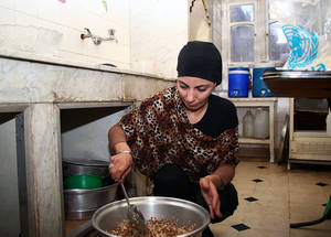 The UNRWA cash assistance programme supplements Nisreen's food assistance, allowing her to put enough money aside to pay her monthly rent. Damascus, November 2014. © UNRWA/Taghrid Mohammad.